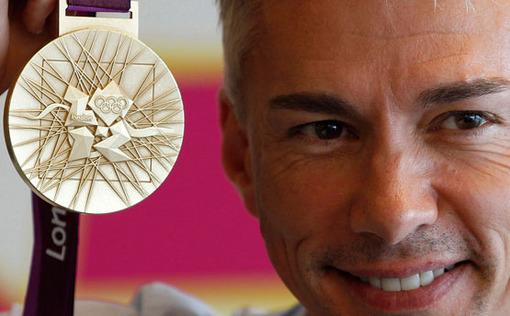 جاناتان ادوارز قهرمان پرش سه گام جهان در مراسم رونمایی از مدال های المپیک لندن، ادواردز یکی از امیدهای انگلستان برای کسب یکی از این مدال ها در المپیک امسال است. Reuters/Stefan Wermuth